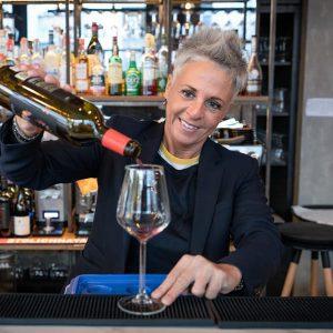 Sommelier serving Greek wine in Athens